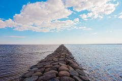 Stone pier going afar to the sea Royalty Free Stock Images