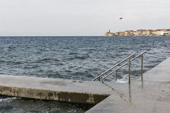 Stone pier with ladder for swimming. Piran, Slovenia. Stock Image