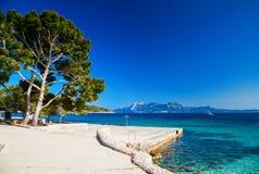 Stone pier near the beach Cala Pi de La Posada. At the cape Formentor, Mallorca, Spain Royalty Free Stock Image