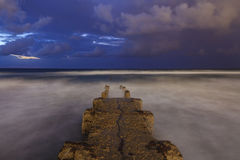 Stone pier off the coast of Tel Aviv. Stock Images