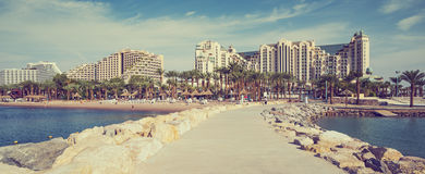 Stone pier at the public beach of Eilat Royalty Free Stock Image