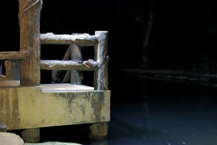 A stone pier on the river Stock Image