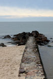 Stone pier. Seascape: calm sea and horizon Stock Photography