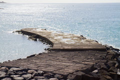 Stone pier in the see Royalty Free Stock Image