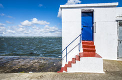 Stone pier with a small building on it Stock Photography