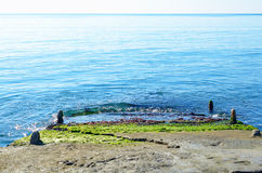 Stone pier stretching into the sea Stock Photo