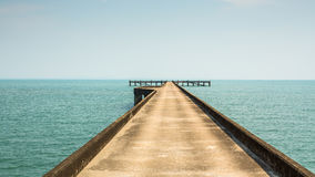 Stone Pier stretching into the Sea. Nature. Royalty Free Stock Photo
