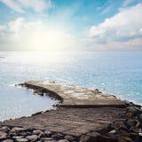 Stone pier at sunny day Stock Photo