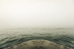 Stone pier in thick fog. Stock Image