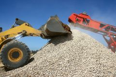 Stone Pile and Machines Royalty Free Stock Photos