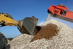 Stone Pile and Machines Royalty Free Stock Images