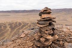 Stone pile mark on the mountain peak Stock Images