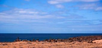 Stone pile in Playa Blanca. Stone pile cairn in playa blanca Royalty Free Stock Images