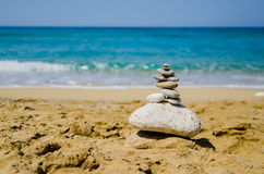 Stone cairn on beach Stock Images