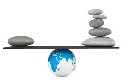 Stone pile in a Zen Garden balanced on a Earth globe. On a white background Royalty Free Stock Image