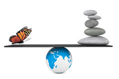 Stone pile in a Zen Garden with butterfly balanced on a Earth gl. Obe on a white background Royalty Free Stock Photography