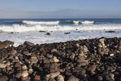Stone piles on the beach in Puerto de la Cruz Royalty Free Stock Photography