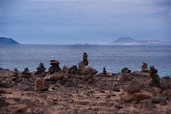 Stone piles in playa blanca Stock Photos