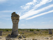 A stone pillar, on the background of blue sky Royalty Free Stock Photography