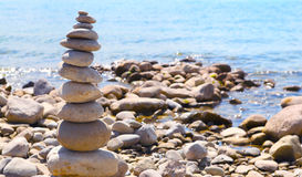 Stone pillar, relaxing by the lake Stock Image
