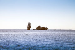 Stone pillar in the sea. Stone pillar east to the sea view Stock Photo
