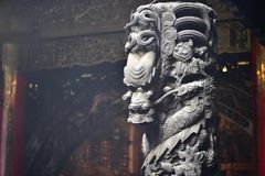 The art of Taiwan temples. Stone pillar of Taiwan temple, carved Chinese dragon for decoration stock image