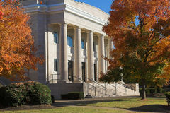 Stone Pillars. Stone building with large pillars, fall colors all around Stock Image