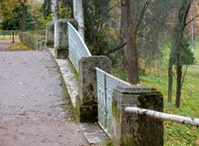 Stone pillars and a metal fence on the bridge in the park