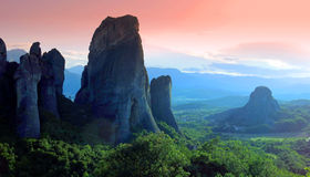 Stone pillars at Meteora, Greece. Stone pillars overlooking landscape at sunset in Meteora, Greece Royalty Free Stock Image