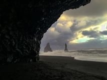 Stone pillars in the sea at Reynisfjara beach, Iceland royalty free stock image