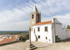 Stone pillory, the former prison and tower bell in Cabeco de Vide town, Portalegre District, Portugal. Stone pillory, the former prison and tower bell in Cabeco stock photos