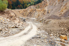Stone-pit. Empty gravel road in stone-pit royalty free stock images