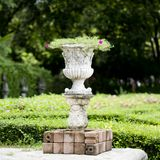 Stone planter with flowers in park Stock Photography