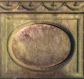 Stone Plaque. Vintage stone circular frame on an old tombstone Royalty Free Stock Photo