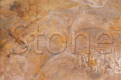 Stone plate with a font in relief Stock Photo