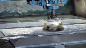 The machine polishes the stone with water, stone slabs stock footage