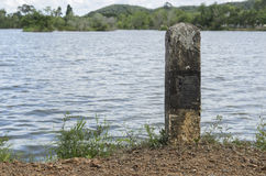 Stone pole next to swamp. Stone pole prevent accident from Laterite road royalty free stock image