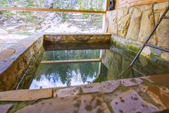 Stone pool outside for cooling after bath in winter royalty free stock photos