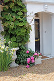 Stone porch with plants and flowers Royalty Free Stock Image