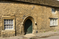 Stone portal on medieval cottage , Lacock. Detail of ancient stone portal of medieval cottage, prospecting on a street in historic touristic village of Stock Photo