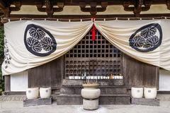 Stone pot with incense sticks and row of votive offerings in the Chion-in Kyoto temple, Japan royalty free stock image