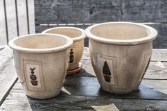 Stone pots placed on a wooden table royalty free stock image