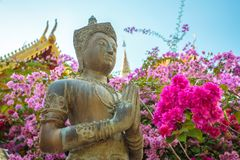 Stone prayer statue in the buddhist temple Royalty Free Stock Images