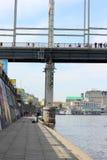 Stone promenade and pedestrian bridge Stock Images