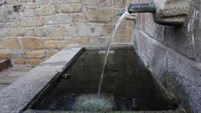 Stone public fountain. With pouring water stock video footage