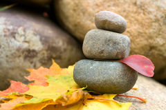 Stone pyramid. With maple leafs Stock Image