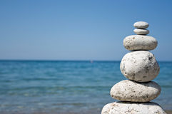Stone pyramid. Zen stone pyramid with sea background royalty free stock photos