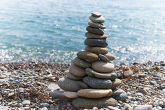 Stone pyramid on the beach Royalty Free Stock Photos
