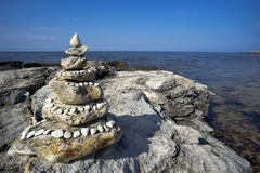Stone pyramid on the beach Royalty Free Stock Image
