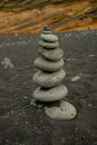 Stone pyramid at black sand Royalty Free Stock Image
